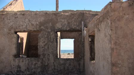 deteriorated : Old ruin at the sea Stock Footage