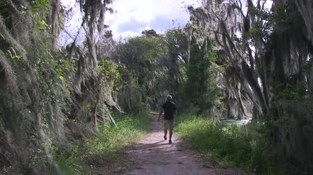 mohás : Man walking in nature preserve Circle B Bar near Lakeland, Florida