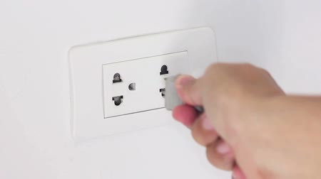unplug : Unplugging Cord From Outlet To Save Electrical Energy.