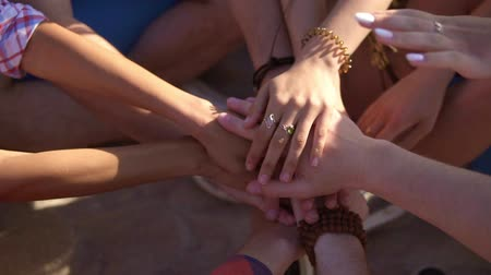 csapatmunka : Closeup view of many hands together united in support. Teamwork and friendship concept. Slowmotion shot