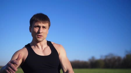 síla : Close up footage of a man exercising with weight. Pumping hand muscles. Caucasian. Open area