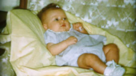 związek : A cute little baby girl smiles sweetly on the sofa at Christmas in 1962. Wideo