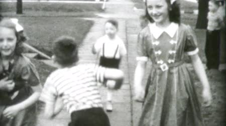 metka : Boys and girls laughing and playing together and enjoying each others company in the summer of 1955.