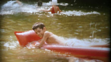 évad : Kids enjoy cooling off during a hot summer by swimming in the lake together in 1964.