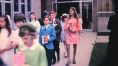 sagrado : A group of girls and boys leave the church after receiving their first communion in the fall of 1962.