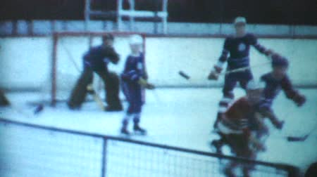 skate : A classic clip of an indoor peewee ice hockey game being played during the winter of 1970 in Canada. Stock Footage