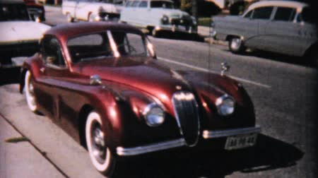 sadece : A beautiful red Rolls Royce parked on the street and a Honeymoon getaway car near Ocean City, New Jersey in 1958.