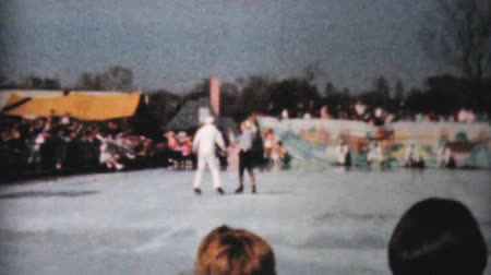 skate : PHILADELPHIA, PENNSYLVANIA, DECEMBER 1962: Scenes from an outdoor Figure Skating year end show including a vaudeville act in Philadelphia, Pennsylvania in 1962. Stock Footage