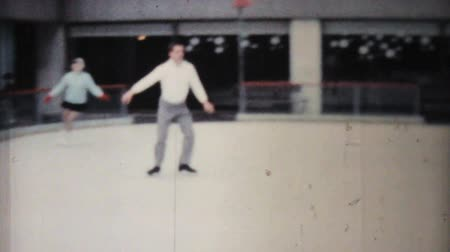 konkurenční : A man enjoys practicing leaping and jumping while figure skating at the Penn Center ice rink in downtown Philadelphia in December 1962.