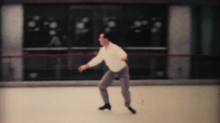 patenci : A man enjoys practicing leaping and jumping while figure skating at the Penn Center ice rink in downtown Philadelphia in December 1962.