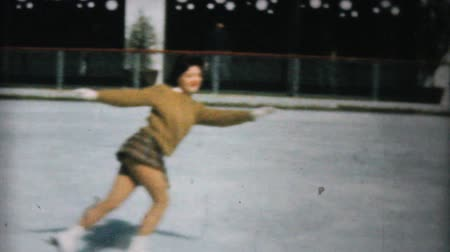 konkurenční : A young girl enjoy practicing figure skating at the Penn Center ice rink in downtown Philadelphia in December 1962.