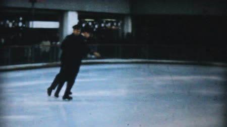 patenci : PHILADELPHIA, PENNSYLVANIA, DECEMBER 1962: A man in a handsome uniform enjoys practicing leaping and jumping while figure skating at the Penn Center ice rink in downtown Philadelphia in December 1962.