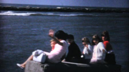 veleiro : A family spends time together at the ocean watching a big ship sail past in 1967.
