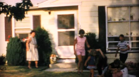 sul : Grandchildren enjoy playing in front of their Grandmas house in the summer of 1967.