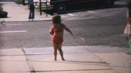 żart : A cute little 6 year old girl dances on the sidewalk in her bathing suit on her way to the beach in Florida in 1967. Wideo