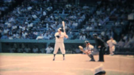 kibice : A batter takes some swings at the ball at a major league baseball game in New York in the summer of 1967.