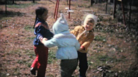 żart : Cute kids playing Ring around the Rosy, running around, and having fun with one another in the fall of 1961.