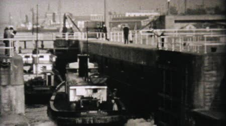 haladás : A fishing boat goes through the locks in Seattle, Washington in 1940. Stock mozgókép