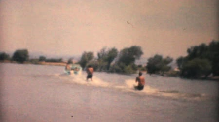 göl : A family enjoys time together water skiing on the lake during the summer of 1961.