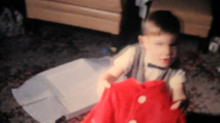 związek : A cute little boy gets a handsome red sweater on Christmas morning in 1962.