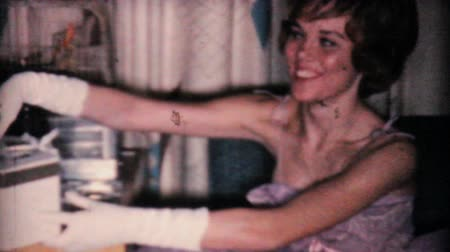 tarihleri : A gorgeous girl in a lavender dress gets a pretty corsage from her grad date in 1962. Stok Video