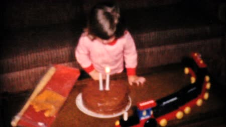 związek : A cute little two year old girl blows out the candles on her birthday cake in 1961. Wideo