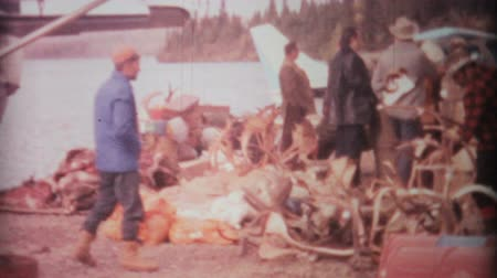 kürk : A bunch of hunters stand around admiring the spoils of their recent hunting trip near the Arctic circle in 1969.