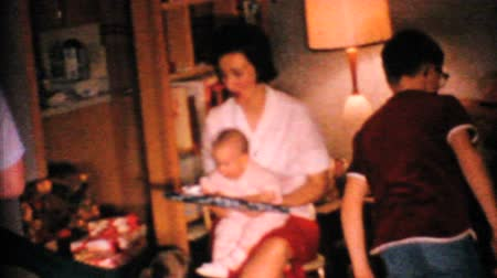 związek : A cute little baby tried to open her own Christmas gift with her Mothers help in 1967. Wideo