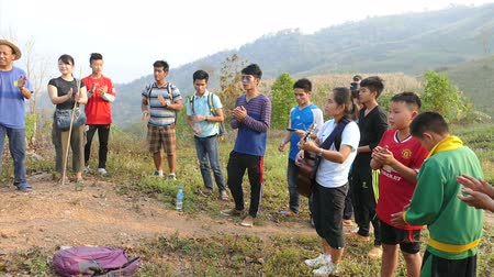hill tribe : A group of Asian Christians singing praise and worship songs on top of a mountain in Chiang Rai, Thailand.
