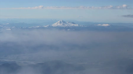 alpy : A cool shot of Mount Baker slipping beneath the clouds as the airplane begins its descent into Vancouver, BC.