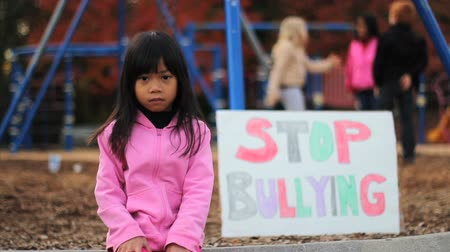abuso : An angry little Asian girl tries to send an important message about bullying at her school. Stock Footage