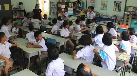 english class : A group of Asian school children enjoy playing fun games during an English class taught by a youth short-term missions team in Ratchaburi, Thailand.