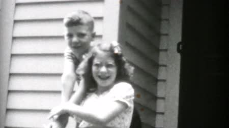pigtailler : Kids being silly on the front steps goof around for the cameras in the summer of 1955.