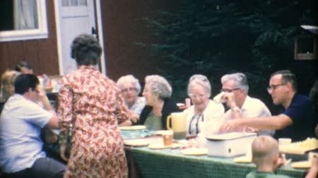 сбор винограда : A mom serves delicious birthday cake to her family at the big summer reunion in 1967.