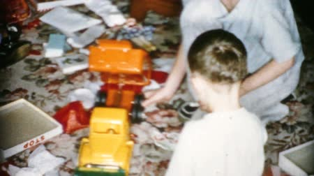 A happy boy gets a really cool dump truck toy on Christmas morning in Cleveland, Ohio in 1956.