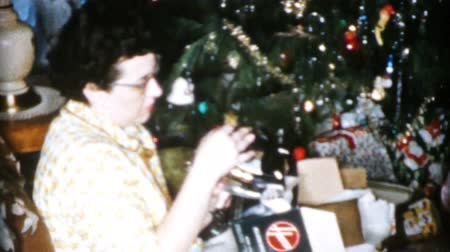 Mom gets a brand new iron and mixer for Christmas in Cleveland, Ohio in 1956. Stock mozgókép
