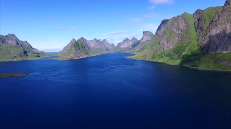 tájak : Aerial footage of beautiful scenery of fjord on Lofoten islands in Norway, popular tourist destination. Aerial 4k Ultra HD.