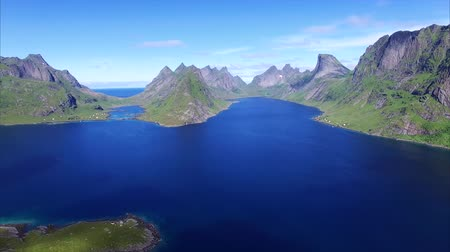 norvégia : Fast flight above fjord on Lofoten islands in Norway, popular tourist destination. Aerial 4k Ultra HD. Stock mozgókép