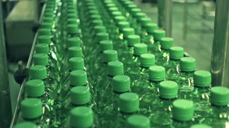bitki : Plant for the production of soft drinks.Plastic containers moving through the pipeline, various angles and sizes. Stok Video