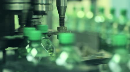 drink industry : Plant for the production of soft drinks.Plastic containers moving through the pipeline, various angles and sizes. Stock Footage