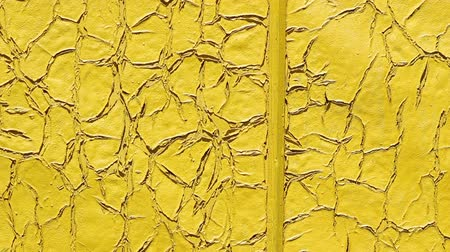 sıva : Texture cracked times yellow paint. Stok Video