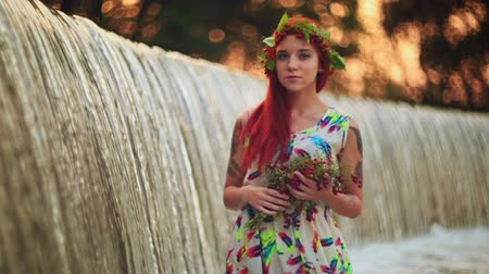 kifinomult : Bright girl with red hair. With a bouquet of berries and leaves on his head. The girl with a tattoo nature.  Bright modern summer makeup. Beauty, spa, manicure  and skincare concept