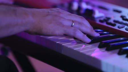 piano parts : hands playing the piano Stock Footage