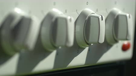 cooktop : Switching electric stove knobs Stock Footage
