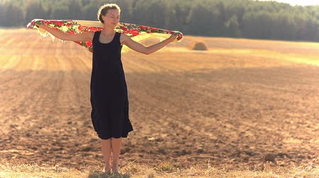 ventoso : Girl on a background of field in a strong wind.