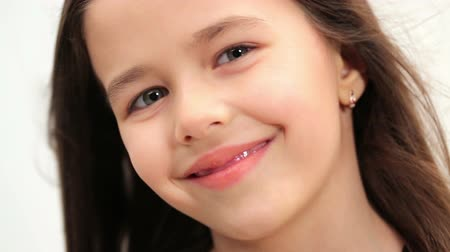 little : Beautiful girl, brunette with green eyes Stock Footage