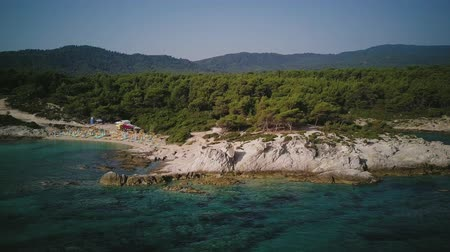 macedonia : Man on rocky beach aerial shot, Sithonia, Greece Stock Footage