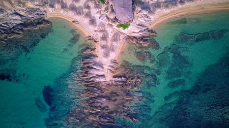 villaggio turistico : Man on rocky beach aerial shot, Sithonia, Greece Filmati Stock