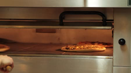 calabresa : Pizza baking in stone oven