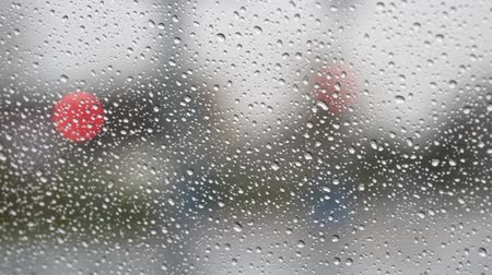 pane : Raindrops on window glass and car traffic Stock Footage